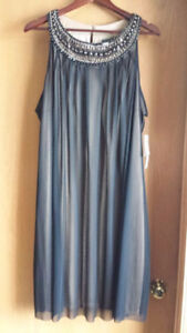 Brand new never worn with tags on David's bridal size 22 dress