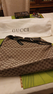 New Gucci Purse tag still on 14 inches x20 inches high 300.00