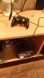 Game cube + controller + memory card + 25 games