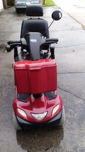 Invacare Pegasus   4 wheel mobility scooter with charger, front