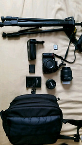 Nikon D5100 with extra lens and accessories.