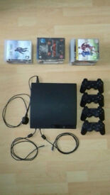 PS3 Slim With 21 Games And 4 Sony Official Pads