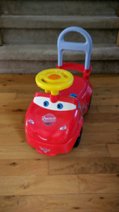 Ride on lightning McQueen car with sounds.