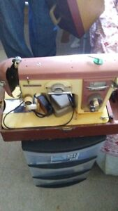 2 Singer Portable Sewing Machines