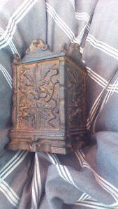 Antique piggy bank. Very OLD. Cast iron. Pot leaves on it?