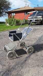 Antique Stroller suited for a child to use for dolls etc.