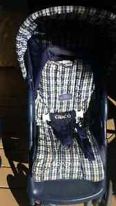 Graco blue stroller with basket and deep hood , bag and  cover