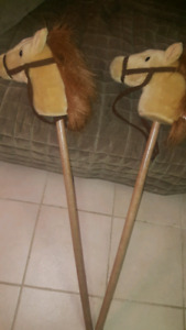 2 Toy stick riding horse for $10