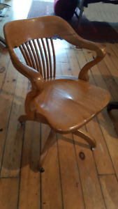 Vintage wooden office chair with swivel base