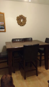 Table with 8 chairs for sale $150.00 or best offer.