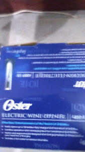 NEW OSTER ELECTRIC WINE OPENER