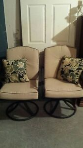 TWO MATCHING SWIVEL PATIO CHAIRS