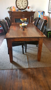 Big heavy solid wood table and leather chairs
