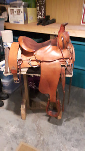 COLLECTOR'S EAMORE ROPER SADDLE WITH COWBOY PROVENANCE.