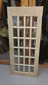 Rustic vintage cupboard doors with beveled glass panes