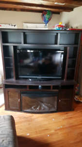 Tv unit with electric fireplace.