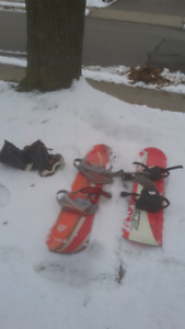 2 snowboards and a pair of boots