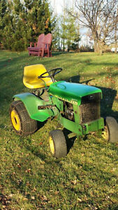John Deere 140 with plow and mower