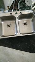 Double stainless steel kitchen sink and Moen taps
