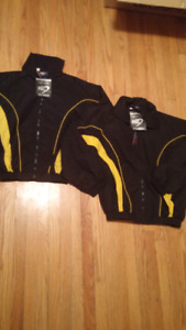 Two youth size Boston Bruins track suit jackets