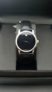 Ladies Movado - stainless steel case and black leather strap
