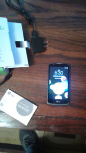 LG K4 Phone with sim card olnly used once.