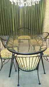 Wrought-iron dining room set with glass-top table
