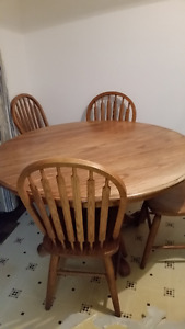 oak pedestal dining table and four chairs for sale