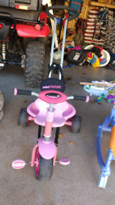 Tricycle with seat belt and pole