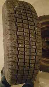 2 Cooper Weather Master Studded Tires on Rims