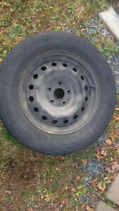 Winter tires on rims for a 2010 Toyota Seinna