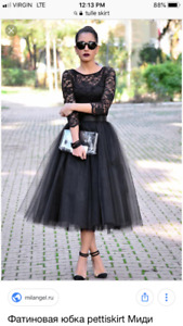 Black tuelle skirt.