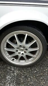 4 USED FRD 17  INCH RIMS.