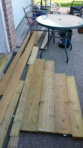 Lot of pressure treated wood , fence post.  $20 for it all