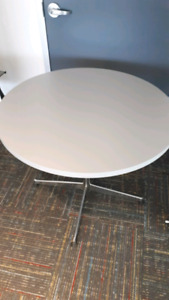 Grey circular conference table