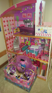 Barbie Doll house with furniture + clothes and barbies