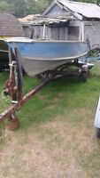 12 ft deep boat and trailer