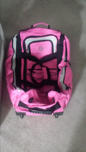 Lrg pink rolling suitcase