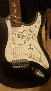 Autographed guitar, signed by the band Underoath