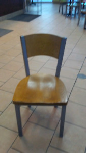 22 custom made wooden chairs.