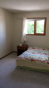 A upstair bedroom with a bathroom for rent in Shawnessy