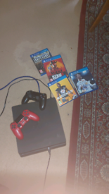 Play station 4 plus 2 controllers and 4 games