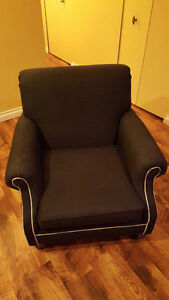 Grey accent chair with white trim