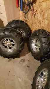 Four SS chrome rims with ITP mud lite tires