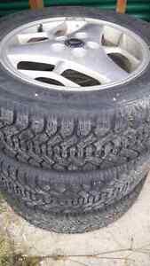 Set of three Winter Tires on Rims 225 60 16