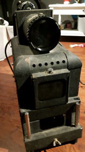 Very cool vintage large over the head slide projector!