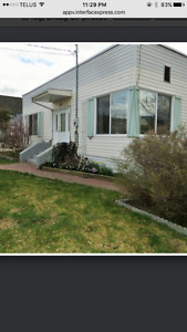 2 rental houses on large R2 lot downtown Penticton,walk to beach