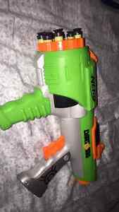 3 nerf guns with attachments and some bullets look at descriptio