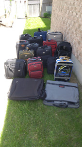 Multiple Pieces of luggage of various sizes.