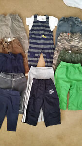 12- Pairs of Pants and 1 Romper Outfit 12-18mths